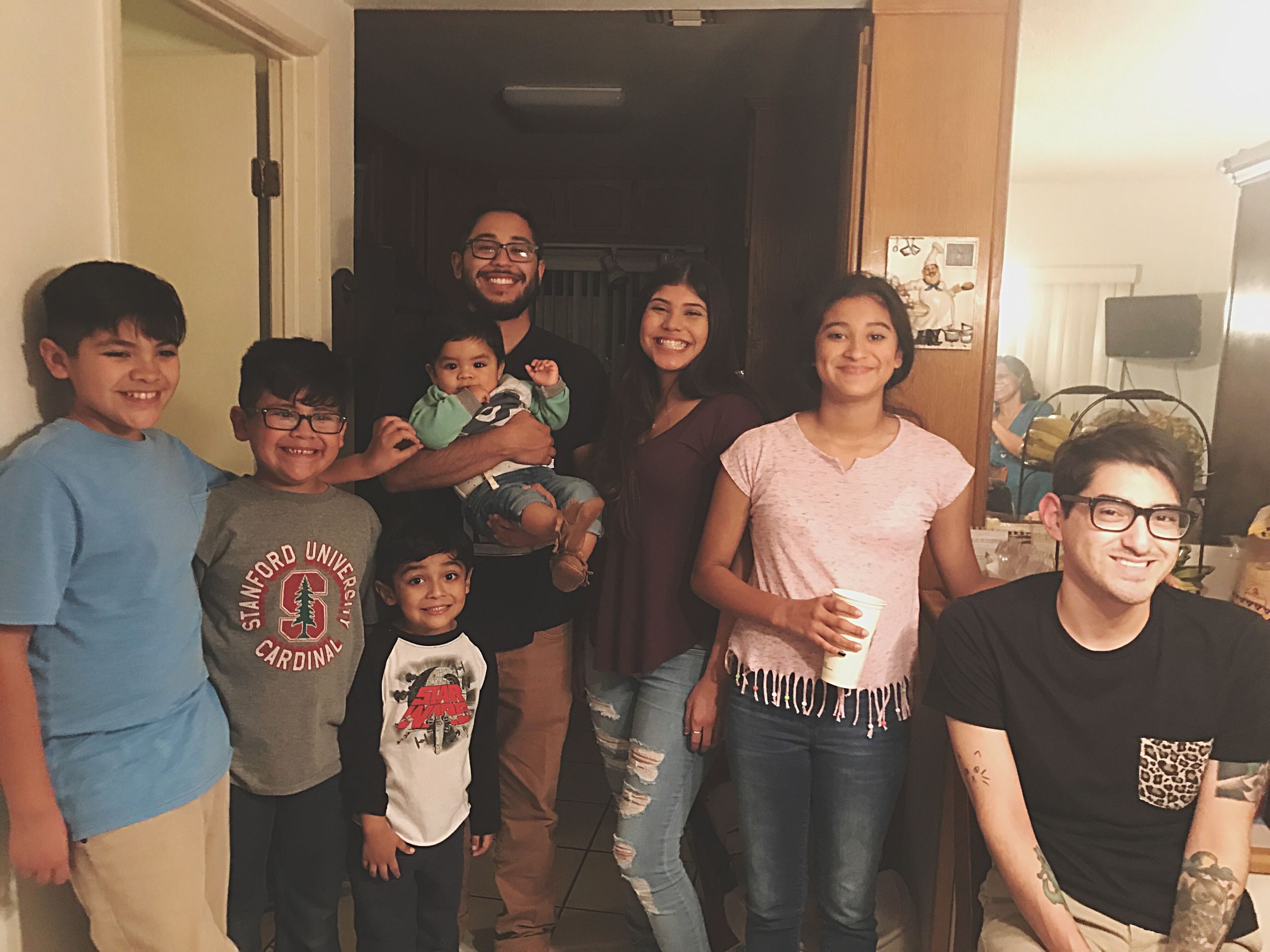 child, girls, boys, medium group of people, standing, looking at camera, portrait, togetherness, people, childhood, night, adult, domestic life, young women, young adult, happiness, indoors, smiling, men