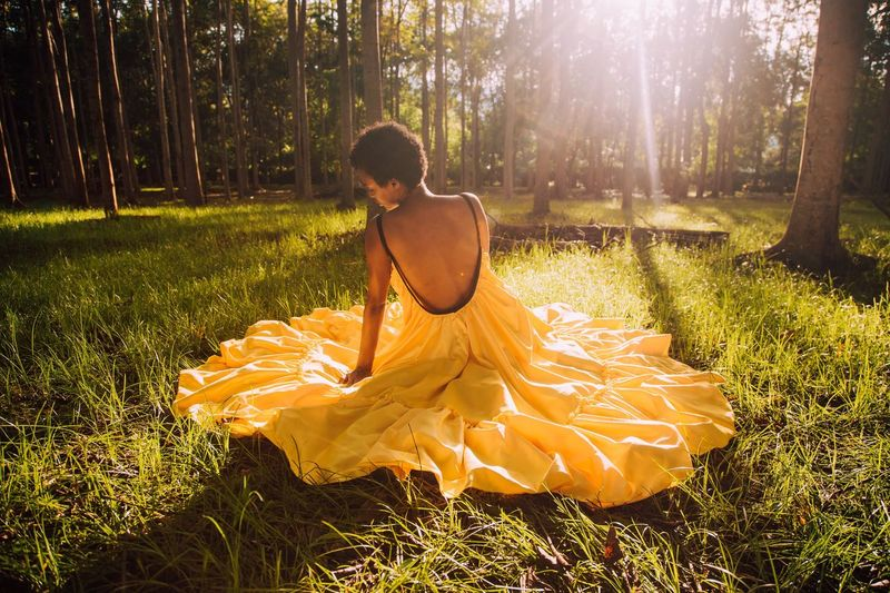 Malaika Warmth Sunlight Lady Sunlight One Person Plant Nature Sunlight Tree Grass Land Lifestyles Adult Hairstyle Sitting Outdoors Young Adult Field Day Rear View Forest