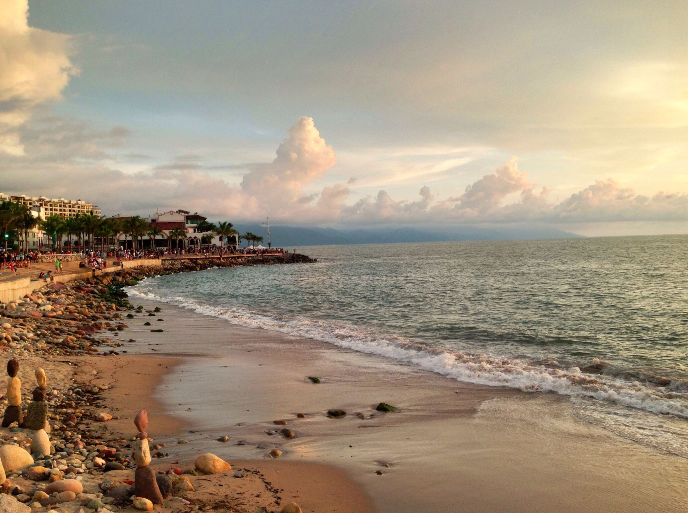 beach, sea, water, sand, shore, sky, horizon over water, scenics, tranquil scene, beauty in nature, tranquility, coastline, nature, cloud - sky, wave, surf, idyllic, incidental people, cloud, vacations