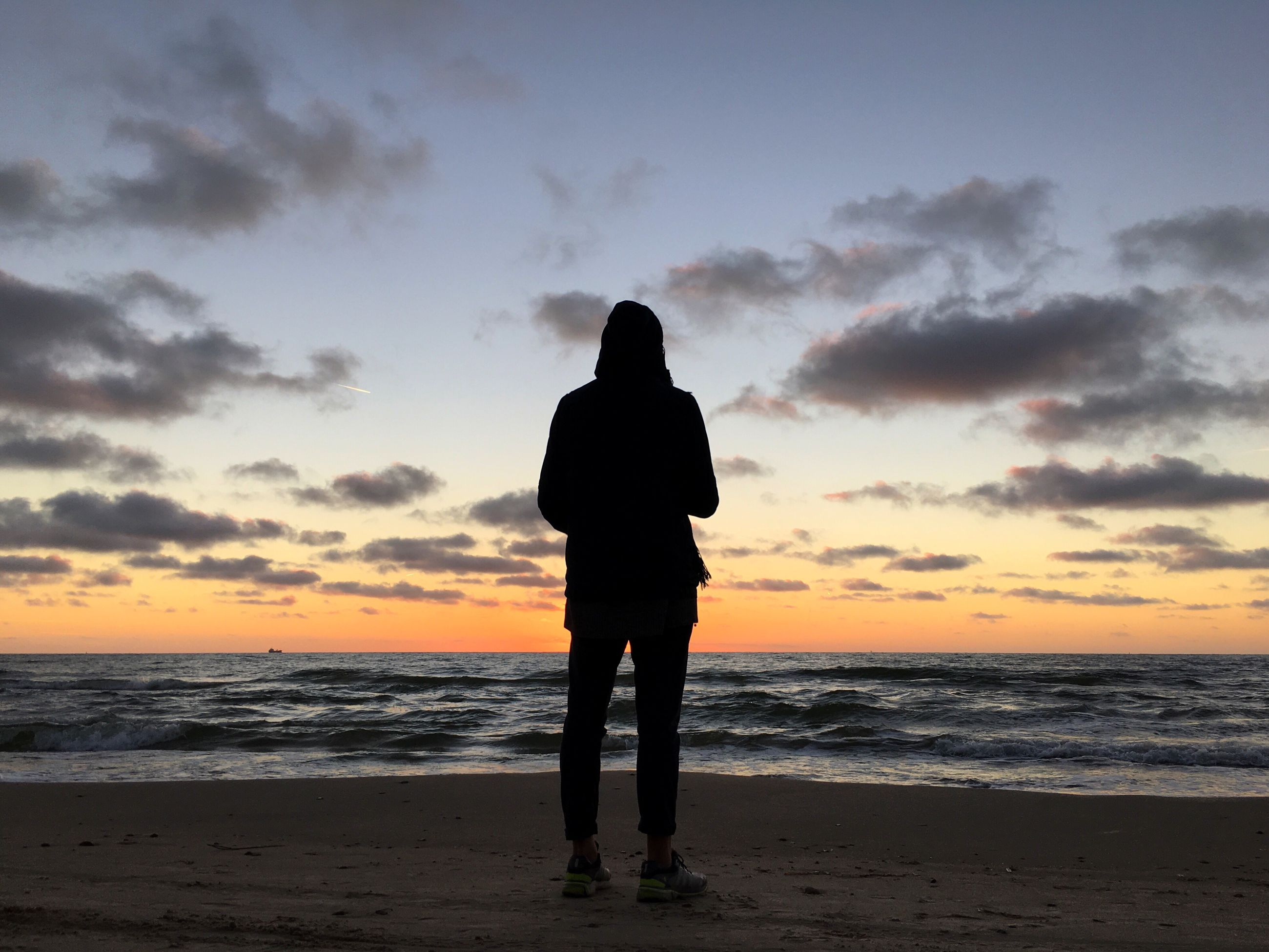 sunset, silhouette, beach, sky, one person, sea, cloud - sky, teenager, lifestyles, outdoors, nature, vacations, people, men, horizon over water, beauty in nature, adult, human body part, one man only