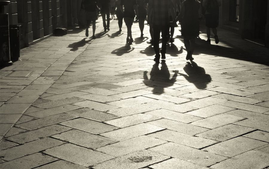 Venice, Italy Adult Black And White City Day Human Body Part Human Leg Lifestyles Low Section Men Monochrome Photography Outdoors People Real People Shadow Sidewalk Streetphotography Sunlight Travel Destinations Urban Landscape Walking