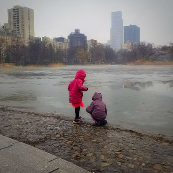 looking for fish, or something City Skyscraper Wet Water Child People Childhood Winter Outdoors Warm Clothing Cityscape