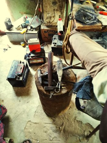 Le bijoutier Smallbusinesssaturday Low Section Occupation Men Human Leg Working Shoe High Angle View Instrument Maker Repair Shop People In The Background Small Business Heroes
