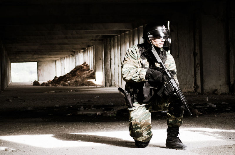 Army soldier with gun in tunnel