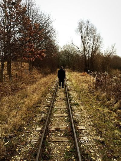 Man walking on train tracks Rear View Tree Full Length The Way Forward Real People Railroad Track One Person Bare Tree Outdoors Nature Beauty In Nature Day People Winter Adult One Man Only Sky Adults Only Denmark Hedeland Let's Go. Together.
