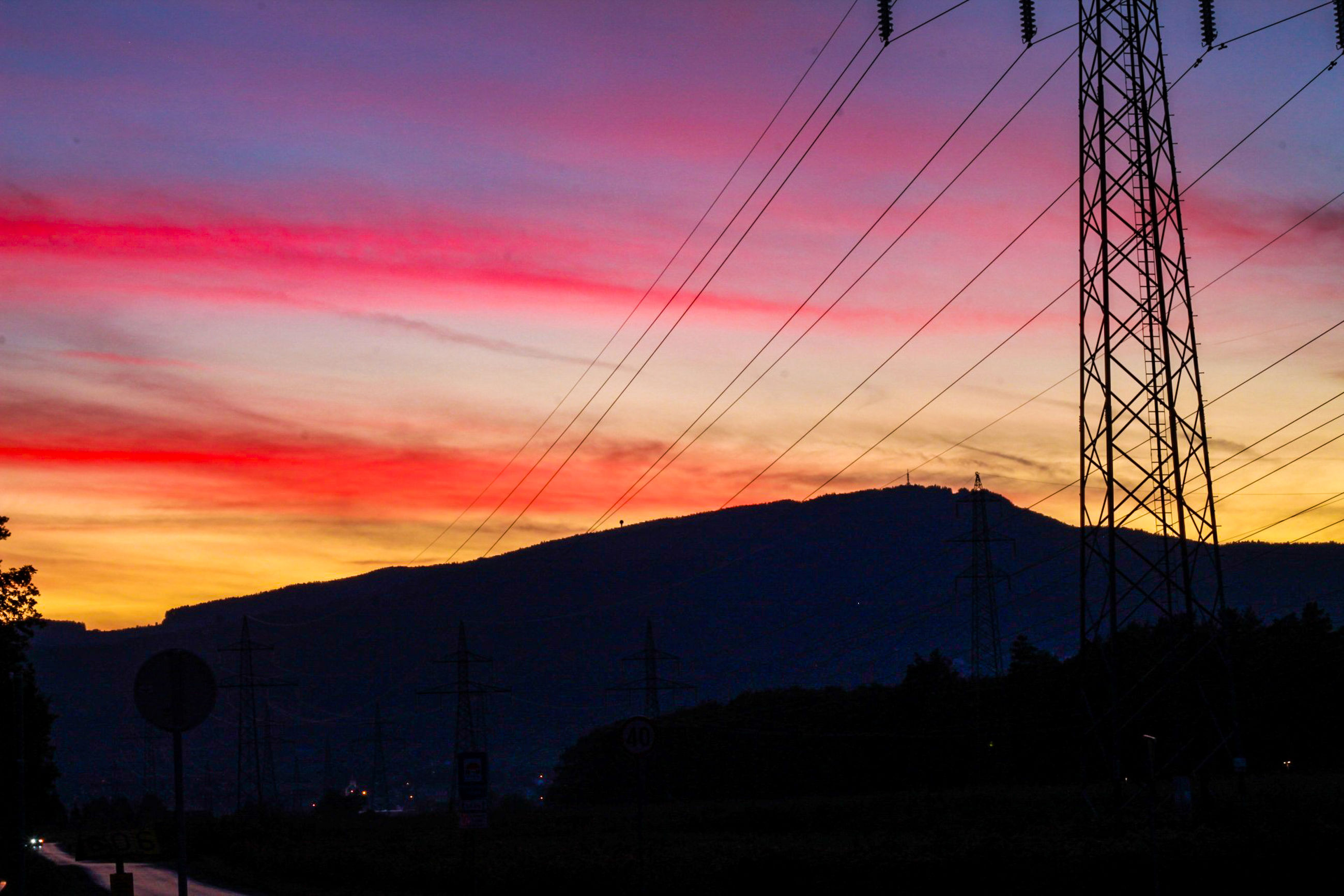 sunset, sky, silhouette, electricity, cloud - sky, cable, power line, beauty in nature, electricity pylon, technology, power supply, scenics - nature, connection, orange color, nature, no people, mountain, low angle view, fuel and power generation, tranquility, outdoors, complexity
