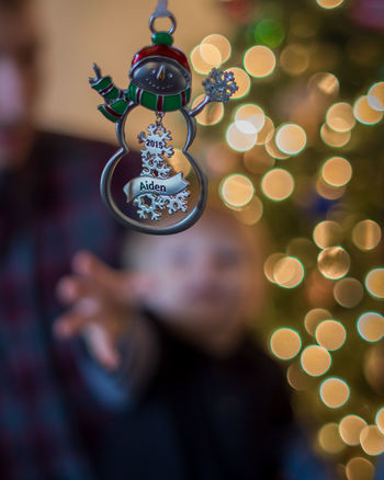 Bokeh Childhood Christmas Close-up Decoration Electric Light Focus On Foreground Glowing Holding Holiday Human Body Part Illuminated Indoors  Lifestyles Light Lighting Equipment Night One Person Real People Selective Focus Shape This Is Family Visual Creativity Focus On The Story #FREIHEITBERLIN
