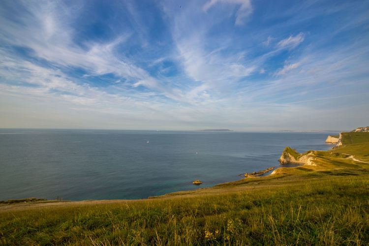 EyeEm Selects Landscape Outdoors Sky Durdle Door Vacations Nature No People Horizon Over Water Constellation Beauty In Nature Travel Destinations Blue Cloud - Sky Rock - Object Water Summer Beauty Grass
