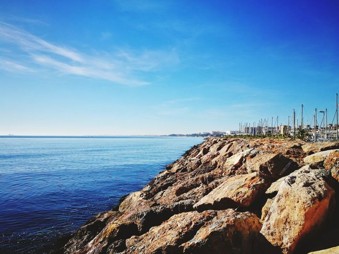 Puerto Aguadulce Almería Southernspain Mediterranean  Harbor EyeEm Selects Sun Clear Water Rocks Building Exterior Sea Horizon Over Water Beach Water Rock - Object Nature Sky Blue Scenics Outdoors Pebble Tranquility No People Beauty In Nature Sunlight Day Clear Sky Pebble Beach Groyne