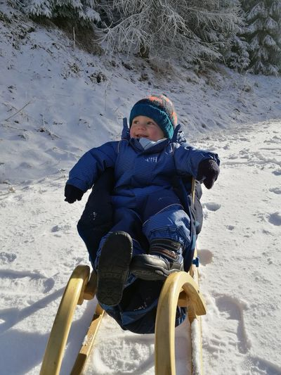 Snow Sports Winter Warm Clothing Child Leisure Activity Cold Temperature Vacations Smiling Sleigh Riding