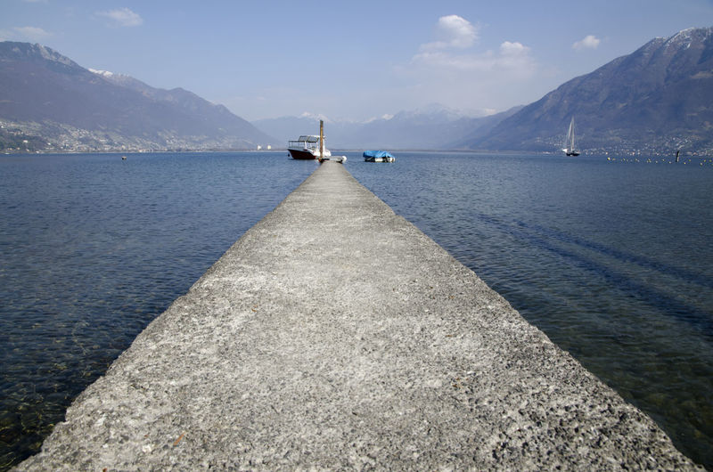 Pier on lake maggiore against sky