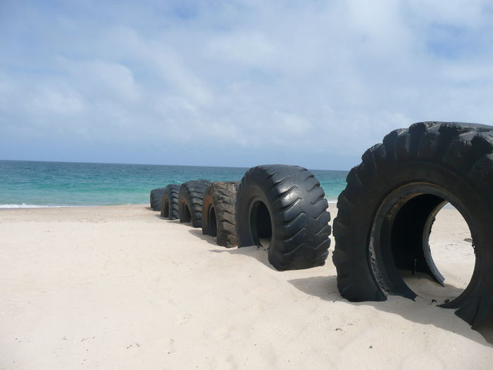 Beach Sand Sea Sky Tire Tractor Tires On Beach