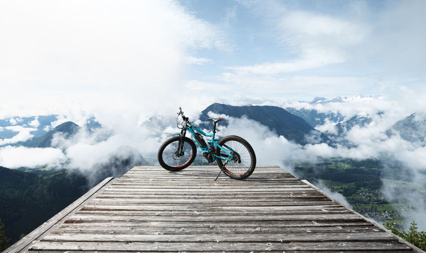 Bicycle on mountain against sky