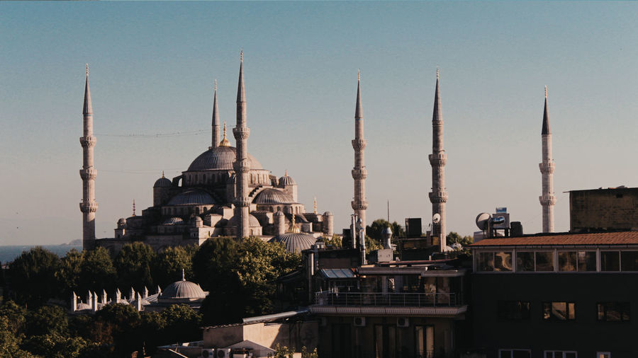 Blue mosque against clear sky during sunset