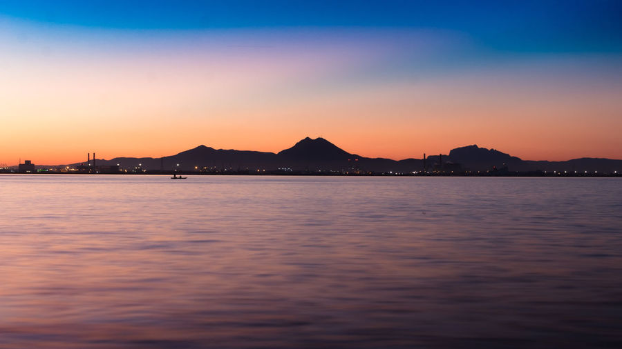 Morning Sunrise Architecture Beauty In Nature Blue Built Structure Clear Sky Day Mountain Nature No People Outdoors Scenics Sea Silhouette Sky Sunset Tranquil Scene Tranquility Water Waterfront