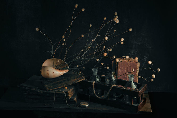 Close-up of objects on table in darkroom