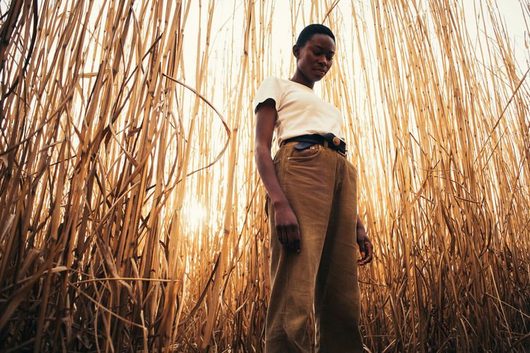 Low angle view of woman standing in field