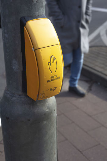 Close-up of yellow text on street