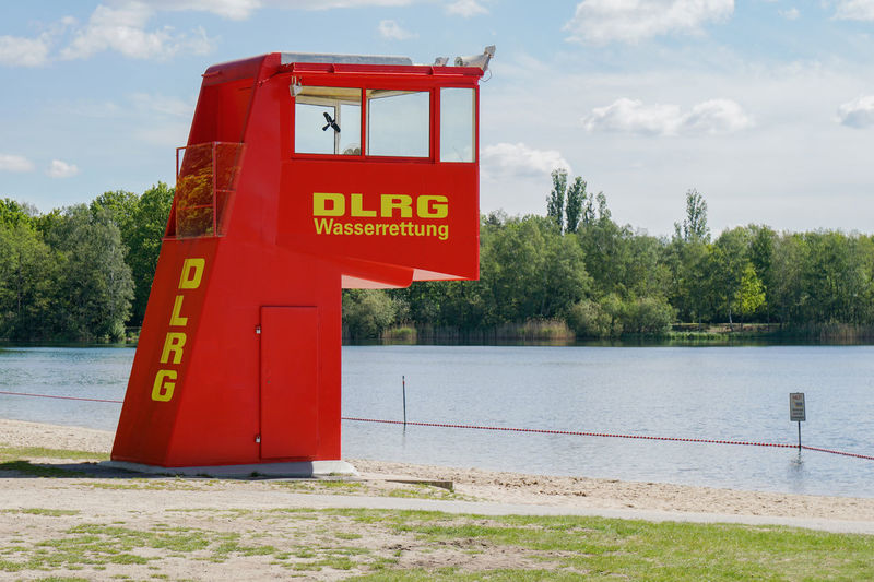 DLRG German Life Saving Association Tree Nature Day No People Outdoors Red Water Lake Security Safety DLRG Bathing Lake Germany Beach Tower German Life Saving Association Lifesaving Lifeguard  Swimming Swim