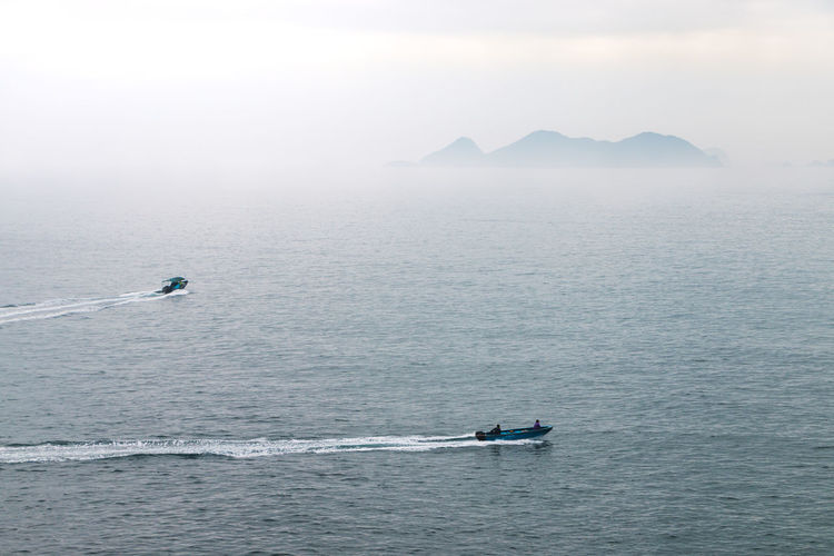 Adventure Beauty In Nature Day Fog High Angle View Jet Boat Leisure Activity Lifestyles Men Mountain Nature Nautical Vessel Outdoors People Real People Scenics Sea Sky Transportation Two People Water Waterfront