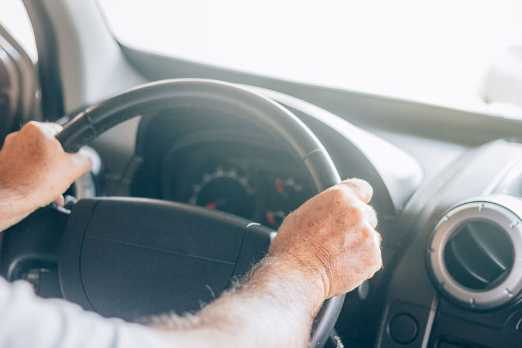 Close-up of man hand holding car