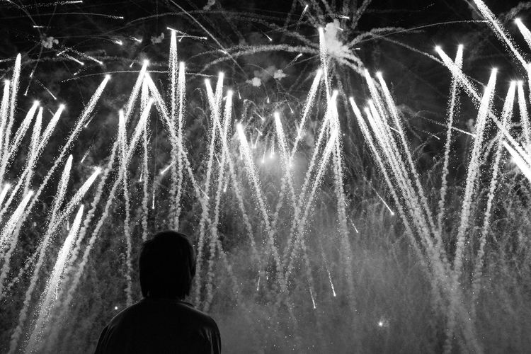 Arts Culture And Entertainment Black And White Celebration Entertainment Event Exploding Firework - Man Made Object Firework Display Glowing Leisure Activity Lifestyles Long Exposure Looking Men Motion Night Outdoors Rear View Sky Sparks Streetphotography Thailand