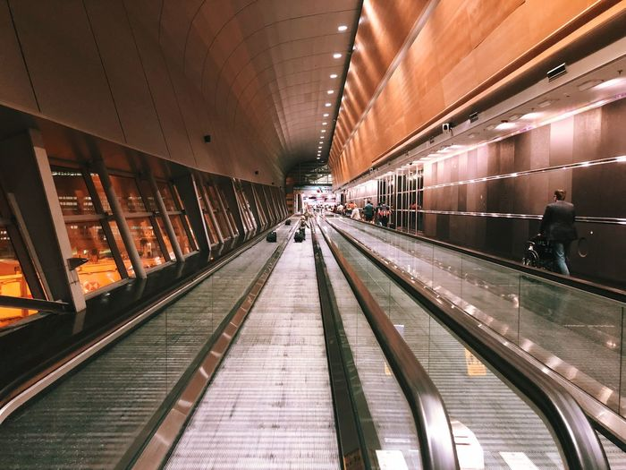 Transportation Architecture Illuminated Indoors  Incidental People Built Structure Direction Rail Transportation Travel Diminishing Perspective Modern The Way Forward Technology Ceiling Public Transportation Lighting Equipment Moving Walkway  Mode Of Transportation Railroad Station Convenience EyeEmNewHere