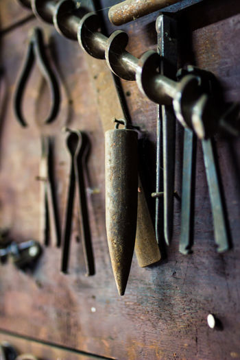 Abandoned Places Carpenter Tools Carpentry Close-up Decay Equipment Hanging On The Wall In A Row Indoors  Metal Metallic Neatly Arranged No People Old Out Of Use  Rows Of Things Rust Rusty Selective Focus Selective Focusing Shallow Depth Of Field Still Life Tools Wooden Work Tool