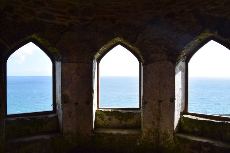 Sea Water Horizon Over Water Arch Architecture Window Built Structure Day Scenics Nature No People Sky Beauty In Nature Sunlight Tranquility Indoors  Cornwall Uk Lookout Point Lookout Post Stone Buildings Seaview