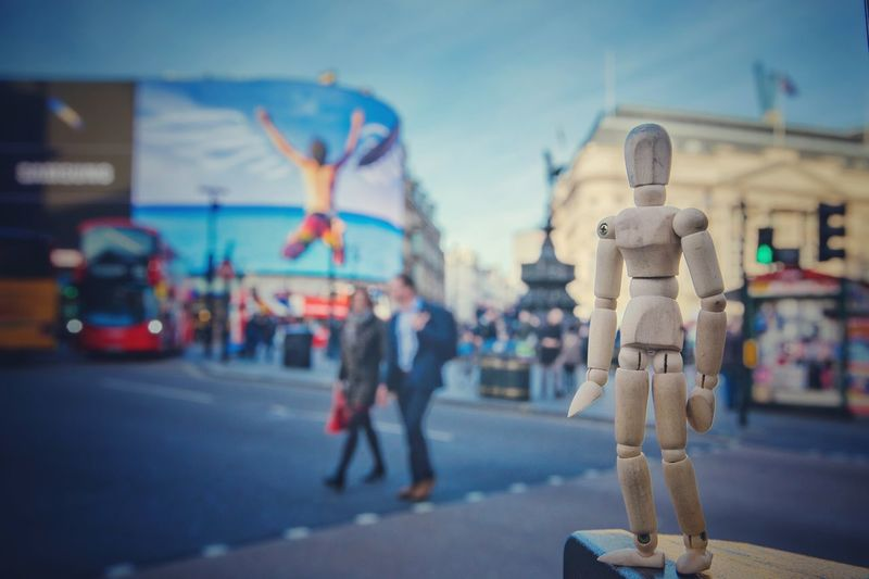 Crossing the Piccadilly Circus Human Representation Focus On Foreground Figurine  Road Day Outdoors Architecture Sky No People Woodyforest London Travel Destinations Picadillycircus Postcode Postcards The Traveler - 2019 EyeEm Awards