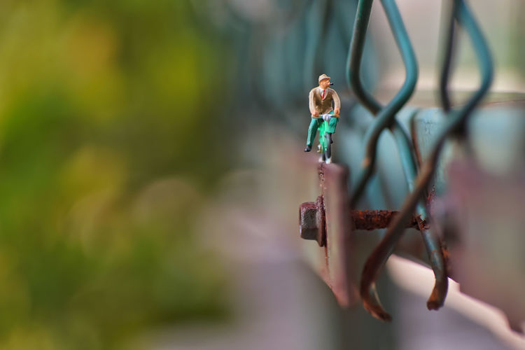 Close-up of figurine toy hanging on wood