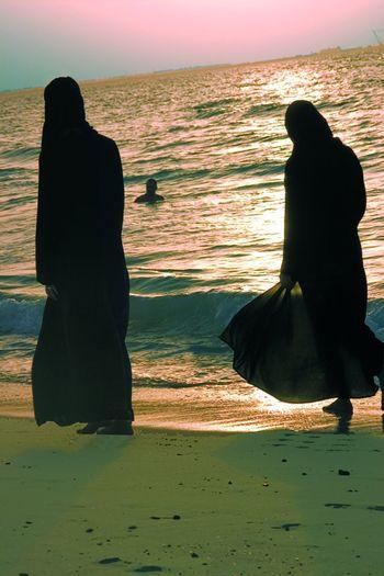 2 Women at Jumeirah Beach Dubai UAE Abaya Beach Hijab Jumeirah Middle Eastern Woman Sea Women First Eyeem Photo