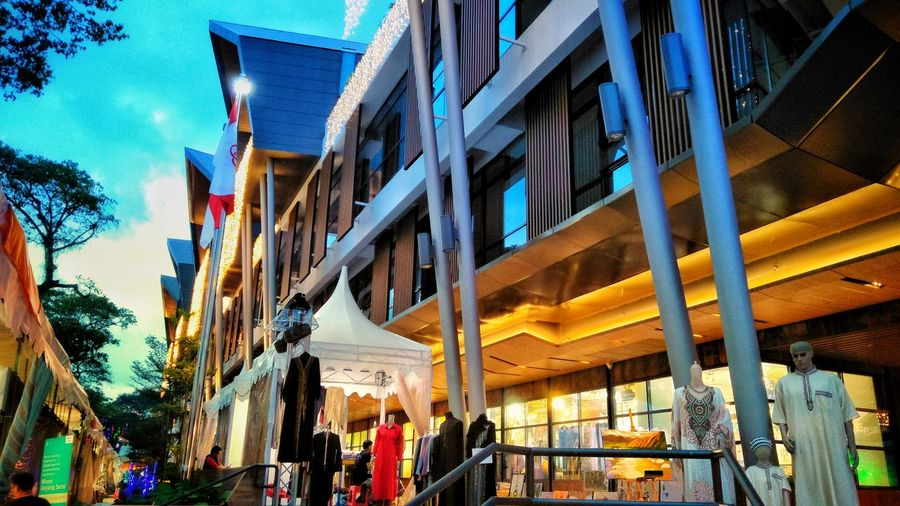 Singapore WismaGeylangSerai Geylang Serai Malay Village Scenery EyeEmNewHere Modernist Kampungstyle Welldesigned Wellstructured Redefine Luxurious Aesthetic Ethos Symbolically Peopleoriented City Flag Blue Sky Architecture Building Exterior Built Structure Building Office Building