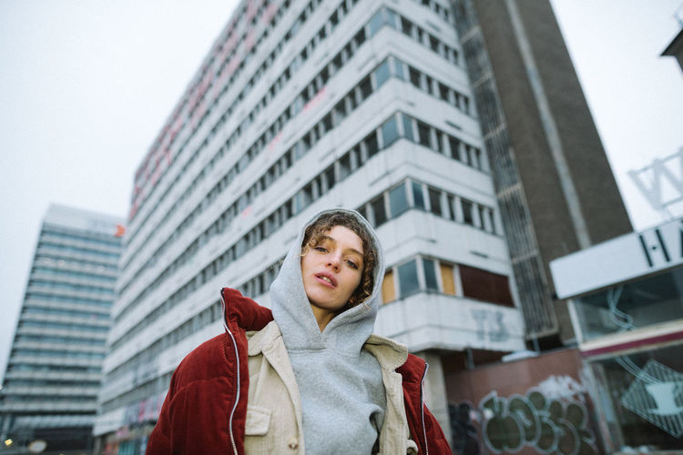 laura. Brutalism Woman City Architecture One Person Building Exterior Young Adult Built Structure Winter City Life Clothing Standing Leisure Activity Waist Up Low Angle View Lifestyles Front View Warm Clothing Coat Young Men Scarf Outdoors Office Building Exterior Winter Coat International Women's Day 2019