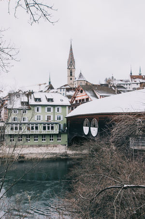 ** Winter Vibes ** Architecture Baden Bridge - Man Made Structure Building Exterior Built Structure Church City City Day Moody Nautical Vessel No People Outdoors River Riverbank Sky Snow Switzerland Tourism Travel Travel Destinations Urban Landscape Urbanphotography Water Adapted To The City