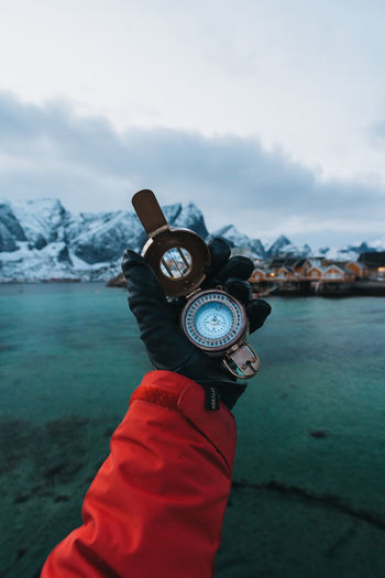 Got a heading in mind? find more travel inspiration at http://www.instagram.com/simonmigaj Compass Direction Lifestyle Travel Adventure Equipment Norway Lofoten Reine Hamnoy Hand Holding Object Travel Photography Travel Gear Mountain Cloud - Sky Winter Water One Person Lake Adult People Nature Day Photography Themes Mountain Range Cold Temperature Scenics Outdoors EyeEmNewHere Go Higher