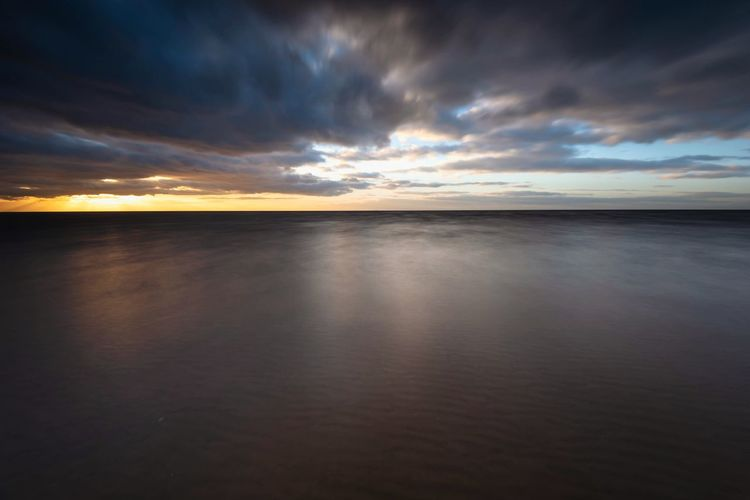 Slow Sunset Clouds And Sky Seascape Sea And Sky Sunset Over Water The Minimalist - 2019 EyeEm Awards Long Exposure Coastline Beach Photography Seaside Hunstanton Norfolk Landscape_photography The Great Outdoors - 2019 EyeEm Awards Sky Water Cloud - Sky Beauty In Nature Scenics - Nature Tranquil Scene Tranquility Horizon Over Water Sunset Reflection Idyllic