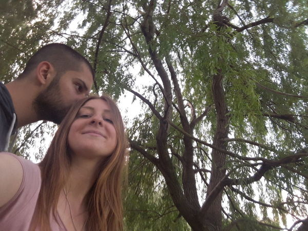 Two People Togetherness Smiling Selfie Happiness Portrait Love Adults Only Cheerful Beard Adult Young Adult People Men Enjoyment Fun Young Women Day Low Angle View Young Men Boyfriend Girlfriend Branch Tree Couple
