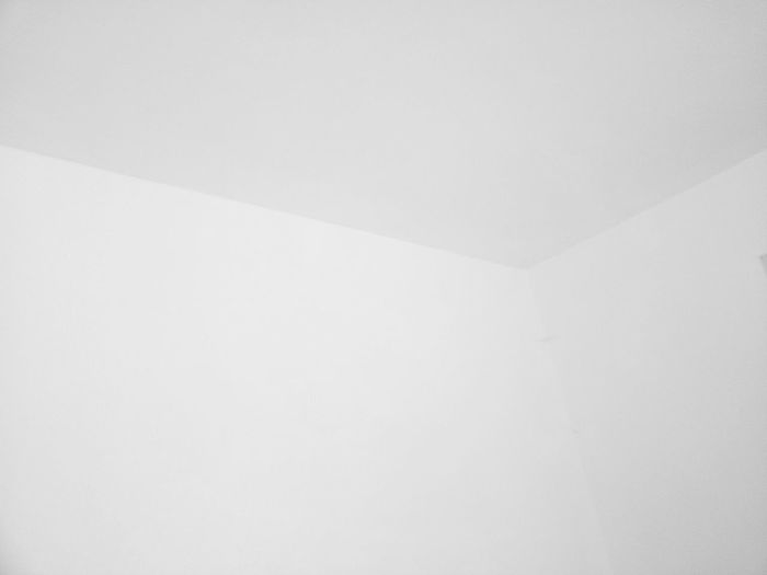 Low angle view of white wall