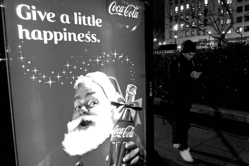 Coca-Cola advertising in a London bus shelter. Black & White After Dark London