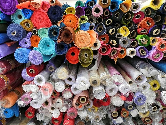 Rolls Of Fabric Fabric Fabric Shop Circular Colours Colors Stacked Materials Textures & Tones Cloth Shades Of Color Upholstery Rolled Rolled Material Rolled Cloth Colours Of The Rainbow Thread Loose Threads Many Colours Texture And Surfaces Tones Of Colour Lines, Colors & Textures Texture Passion Displays The 00 Mission