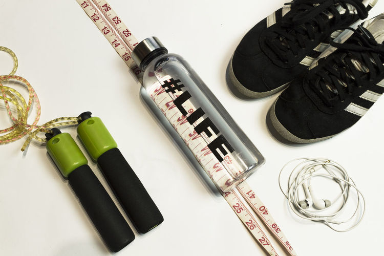 sport concept flat lay Weights Still Life Traning Diet Flatlay Top View Flat Lay Workout Runing Day Sport Fitness Weightloss Indoors  Indoors  Composition White Background Dumbbell Sneakers Measure Tape Active Close-up