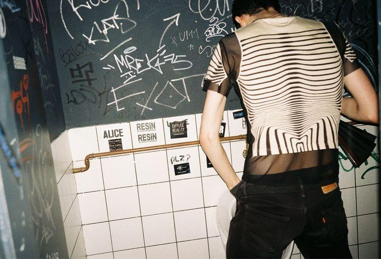 Wall - Building Feature #gaultier #graffiti  #Berlin #bathroom #pissoir #urinal #man Standing Creativity #film First Eyeem Photo EyeEmNewHere