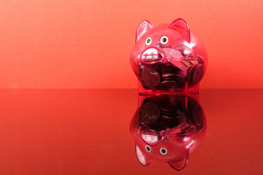 Saving concept with red piggy bank on red background. Piggy Bank Animal Animal Representation Art And Craft Close-up Coin Colored Background Conceptual Photography  Copy Space Creativity Glass - Material Indoors  Investment No People Red Red Background Representation Saving Concept Single Object Still Life Studio Shot Table Toy Transparent Wall - Building Feature