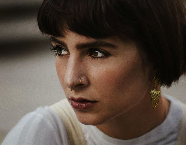 Close-Up Of Thoughtful Young Woman Wearing Nose Ring