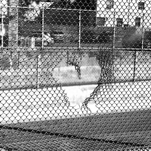 Close-up of heart shape on chainlink fence