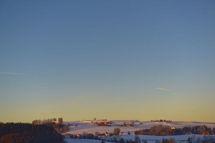 Allgäu Altusried Dawn Sky Snow Winter Cold Temperature Scenics - Nature Copy Space Clear Sky Nature Beauty In Nature Environment Landscape Tranquility Tranquil Scene No People Plant Non-urban Scene Tree Outdoors Sunrise Dawn Allgäu Hill Residential District Building House
