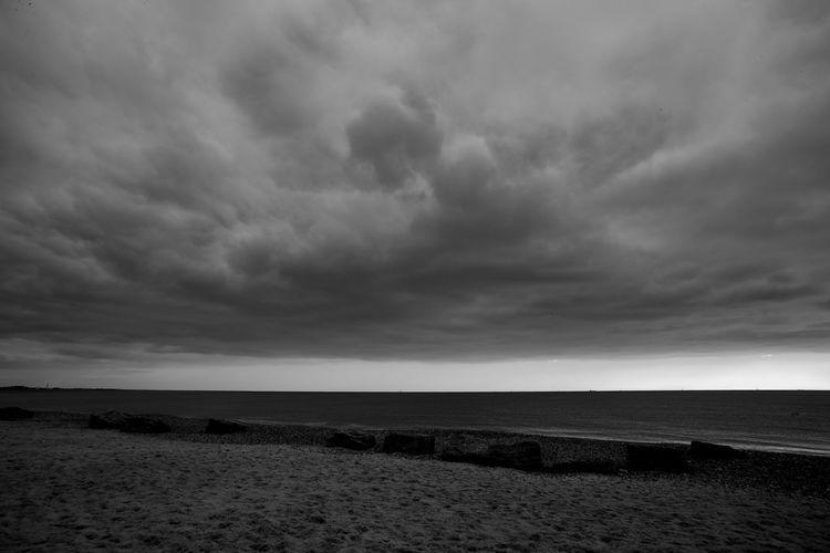 Departing Storm Beach Beauty In Nature Blackandwhite Cloud - Sky Horizon Horizon Over Water Land Nature Ominous Overcast Scenics - Nature Sea Sky Storm Tranquil Scene Tranquility Water