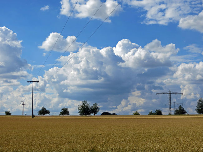 Cloud Cloud - Sky Cloudy Electrical Power Supply Electricity  Energy Fields Landscape Logistics Nature Nature No People Outdoors Power Company Power Line  Power Supply Sky Supply Technology