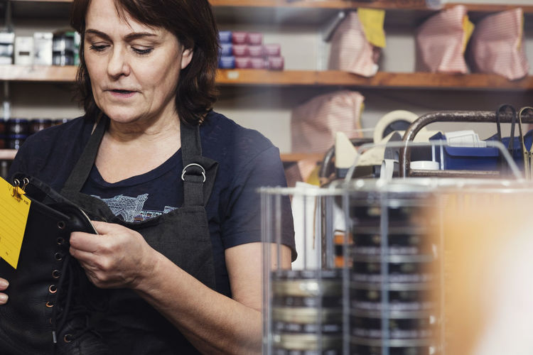 Midsection of woman working at store